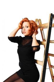 Elegant red-haired girl on white background
