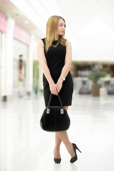 Employee holding her handbag with blurred background