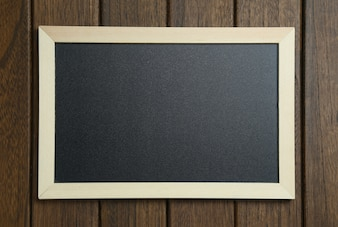 Empty blackboard on vintage wooden background