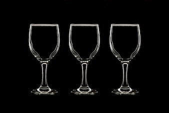 Empty three wine glass on black background