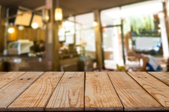 Empty wooden table with blurred cafe, product montage display background.