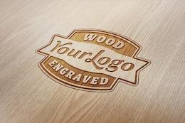Engraved logo on wood PSD mockup