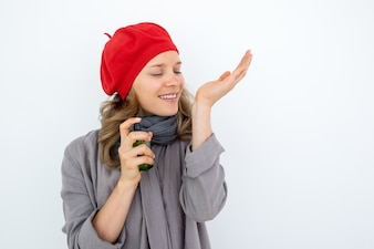 Enjoyable French woman smelling perfume