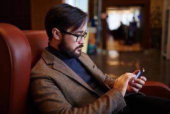 Entrepreneur dialing cellphone idea busy