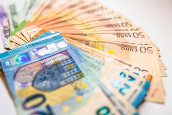 Euro cash. Many Euro banknotes of different values. Euro cash background.