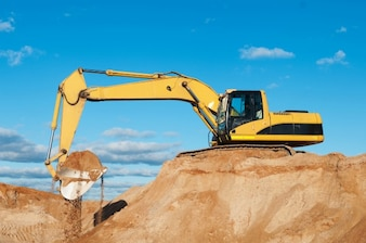 Excavator on a land under construction