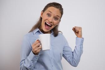Excited businesswoman celebrating winning