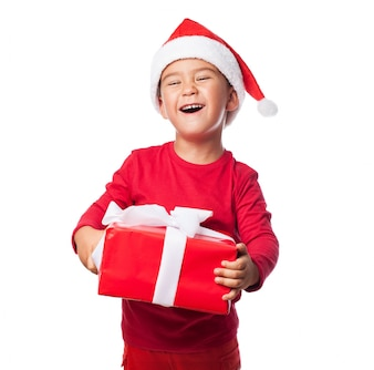 Excited child with his christmas gift