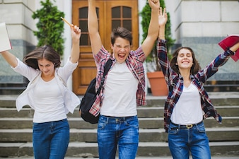 Excited students leaving university