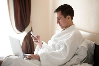 Executive working in bathrobe