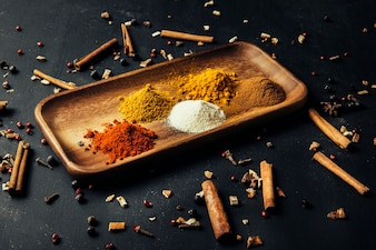 Exotic spices on wooden board with cinnamon