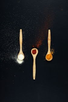 Exotic spices with three spoons