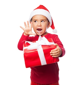 Expectant child with his gift