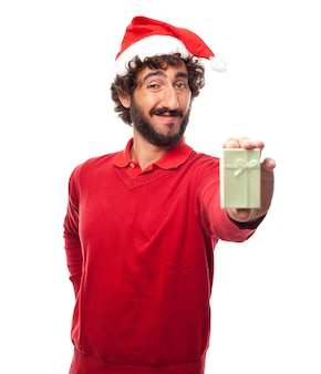 Expressive man with santa claus hat and a small gift