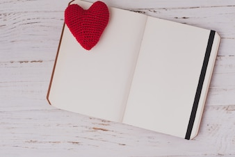 Fabric hearts on an open notebook