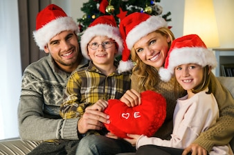 Family smiling with santa hats