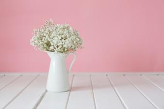 Fantastic white vase on wooden surface