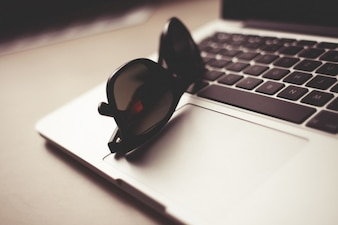 Fashion sunglasses and laptop