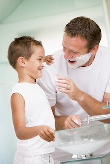 Father and son playing with shaving soap