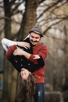 Father holding daughter upside down