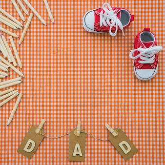 Father's day background with shoes and colored pencils