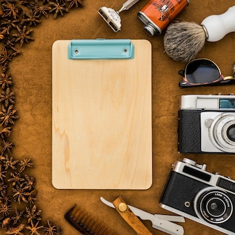 Father's day composition with clipboard and masculine items
