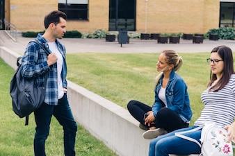 Fellows talking in courtyard