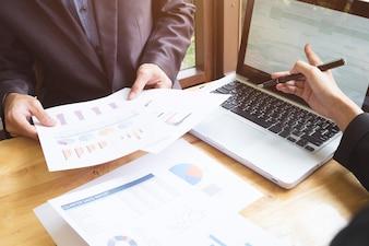Female analyzing finance cooperation tech touchpad
