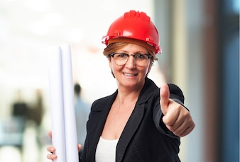 Female architect with thumb up