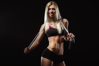 Female athlete with a rubber band