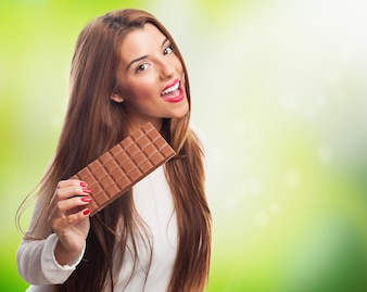 Female brunette with bar of chocolate