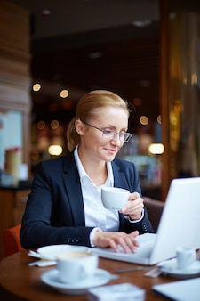 Female executive working in a coffee shop