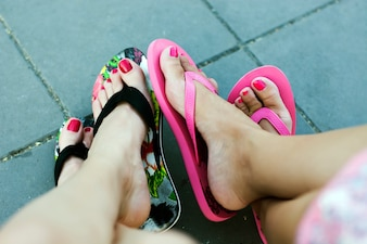 Female friends in summer slippers