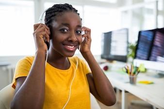Female graphic designer wearing headphones