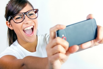 Female making selfie on studio