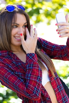 Female making selfie using smartphone
