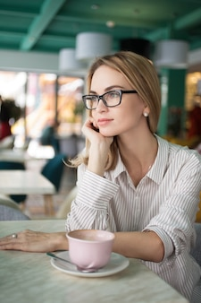 Female woman shop alone daydreaming