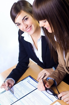 Females working with documents