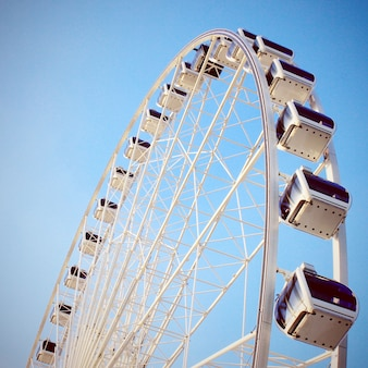 Ferris wheel with clear blue sky, retro filter effect