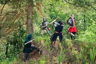 Few knights in armor is fighting