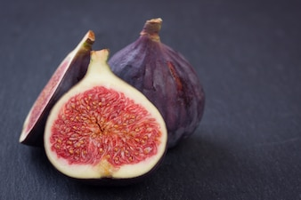 Fig cut in half in a gray background