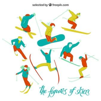 Figures of skiers