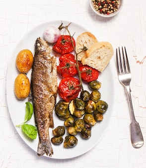 Fish dish cooked with vegetables and bread