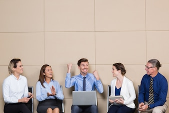 Five Cheerful Business People in Waiting Room