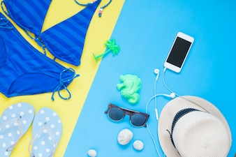 Flat lay creative summer set for girl with smartphone