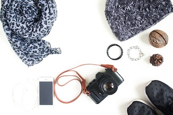 Flat lay photography with camera, cellphone, fashion accessories, essential items for woman , Overhead view, top view