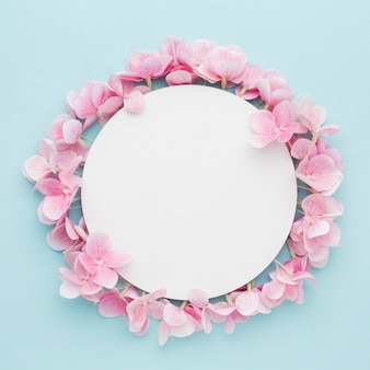 Flat lay pink hydrangea flowers with blank circle