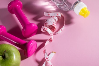 Flat Lay Sport Concept Healthy Life Equipment on Bright Pink Background. Closeup with Copy Space.