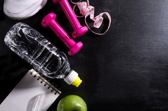 Flat Lay Sport Concept Healthy Life Equipment on Dark Vibrant Background. Closeup with Copy Space.