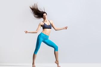 Flexible sportswoman dancing